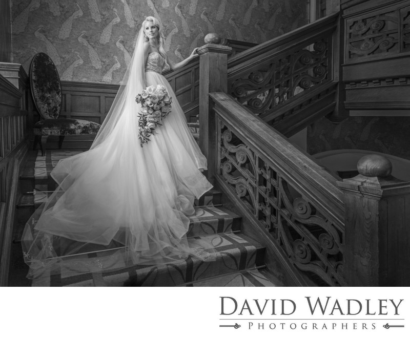 Bride on stairs at Moxhull Hall