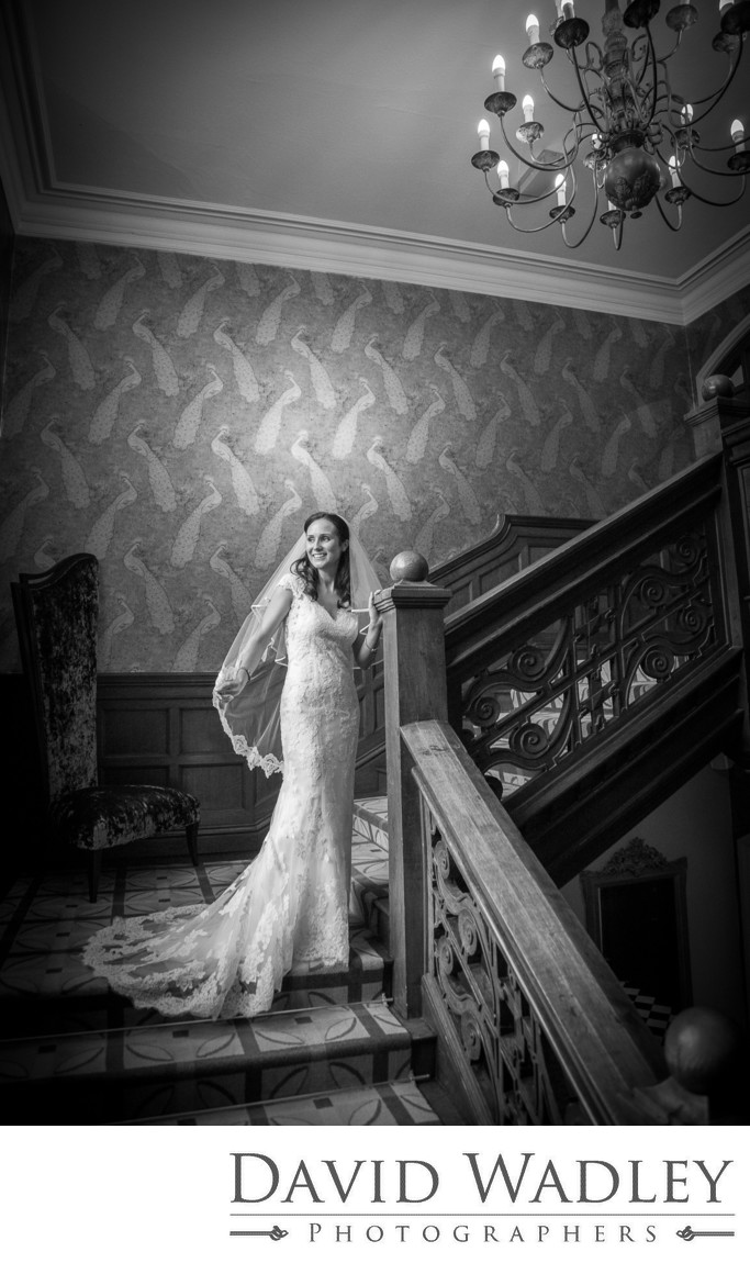 Bride photographed on the amazing stairs at Moxhull Hall Hotel.
