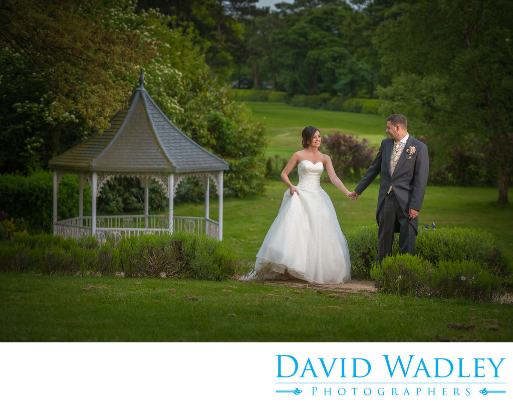 Wedding day photography, walking in the gardens at Moor Hall Hotel.