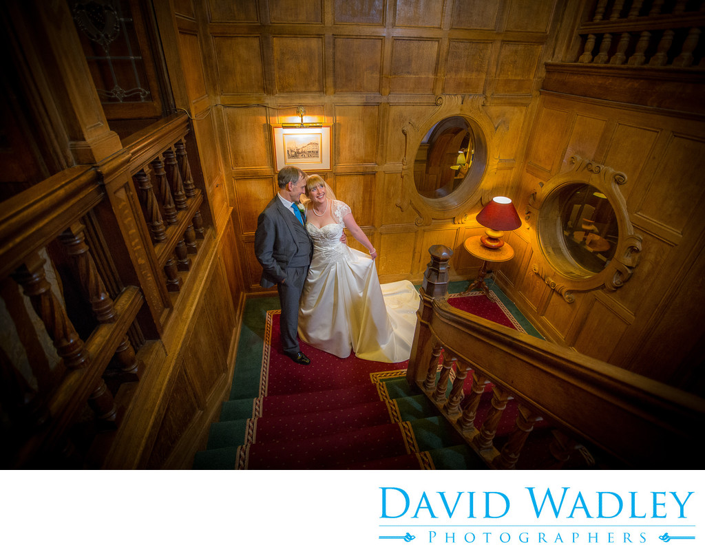 Wedding day photographed on staircase at Moor Hall Hotel.