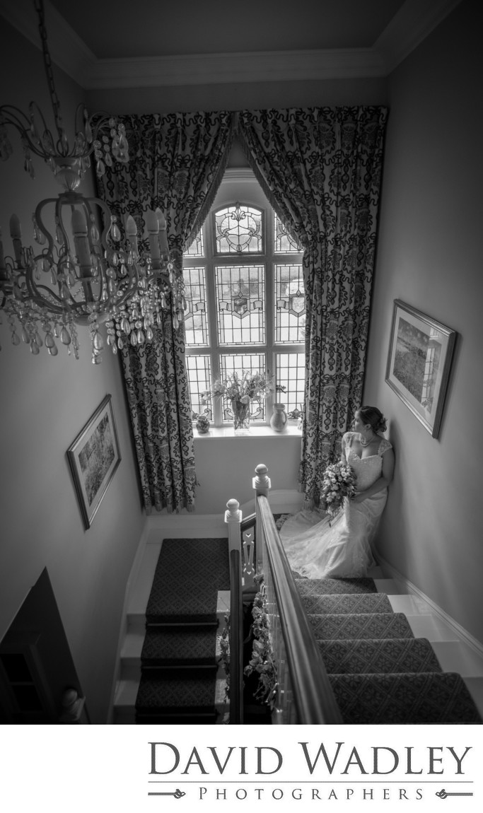 Bride on stairs at Grafton Manor.