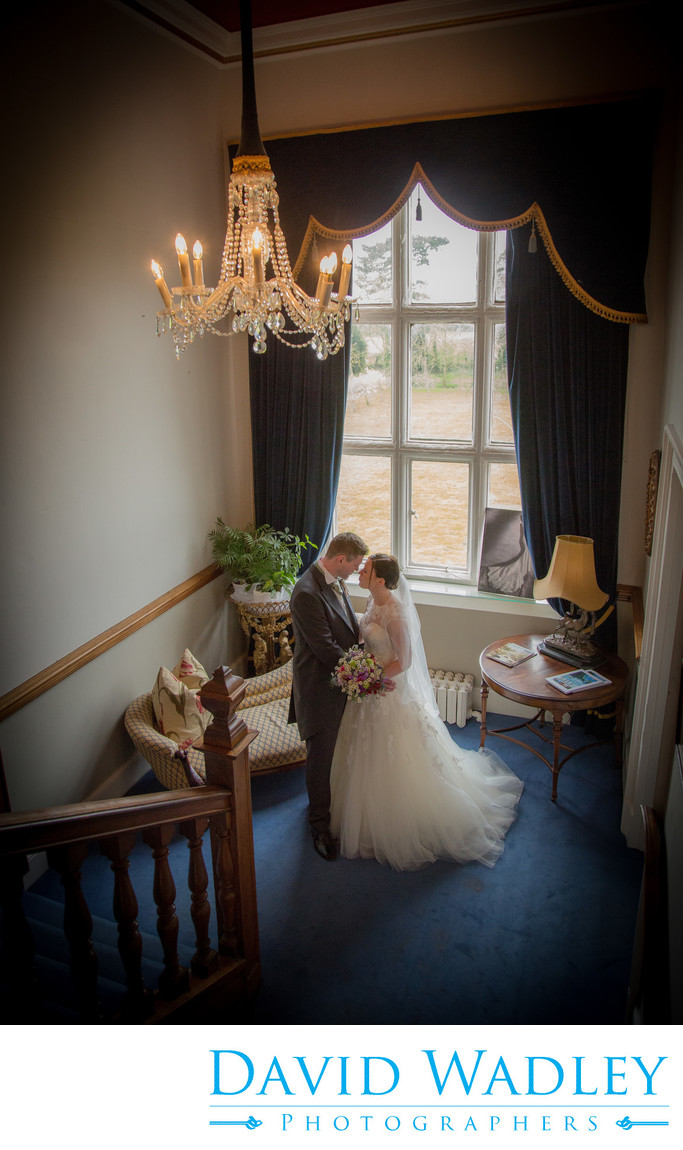 Beautiful staircase at Grafton Manor Hotel with the Bride & Groom.