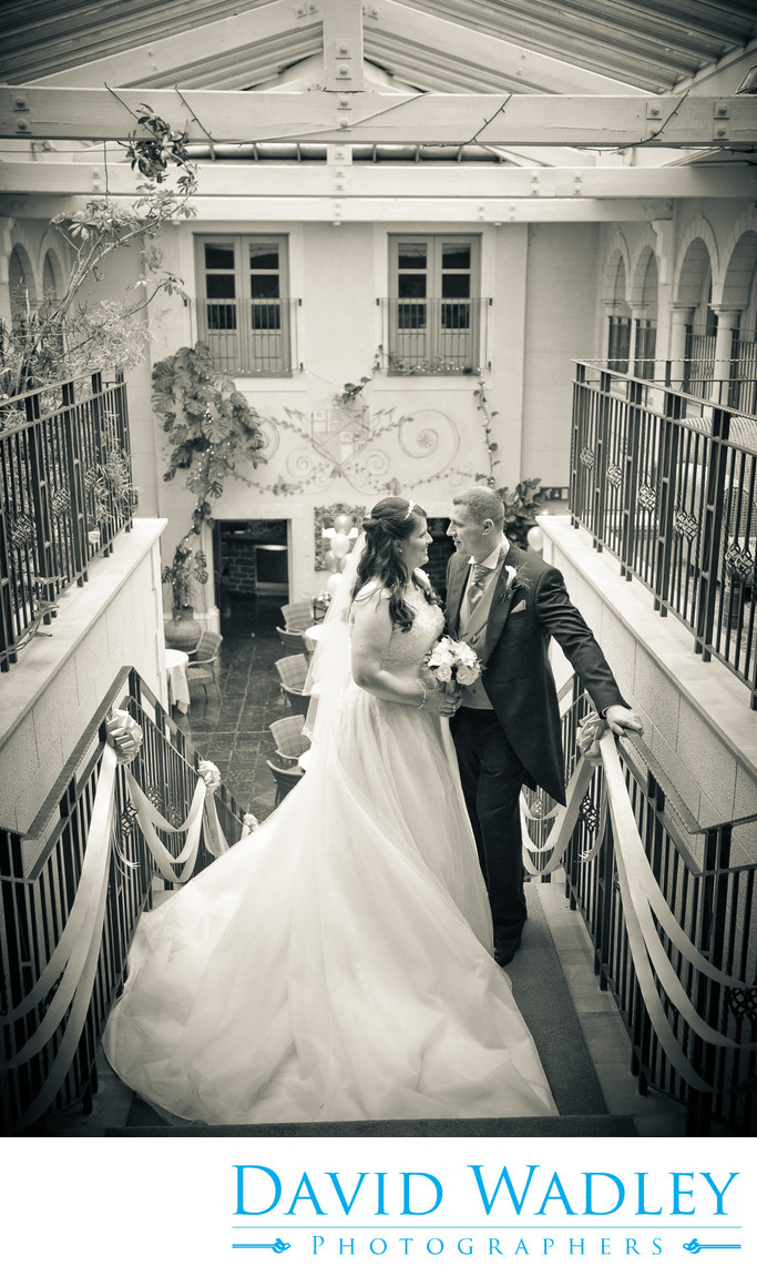Bride & Groom at the top of the stairs at Nailcote Hall.