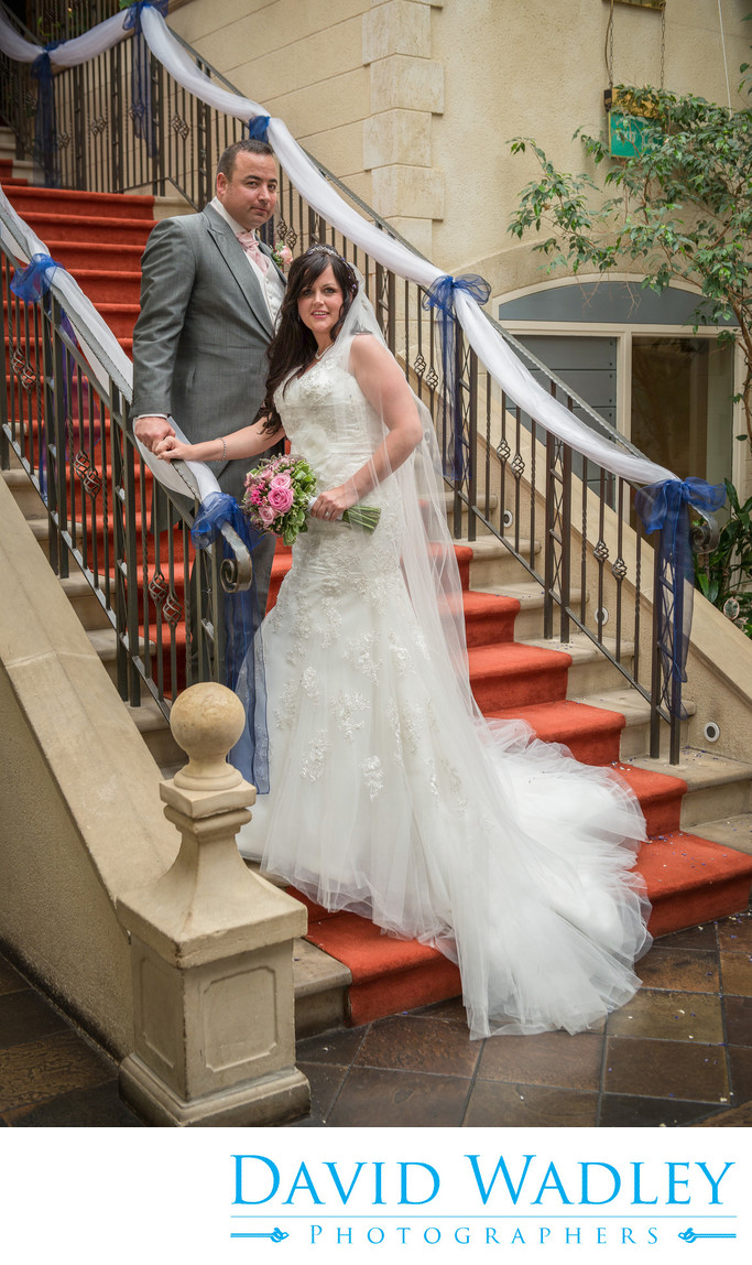 Bride & Groom on stairs at Nailcote Hall.