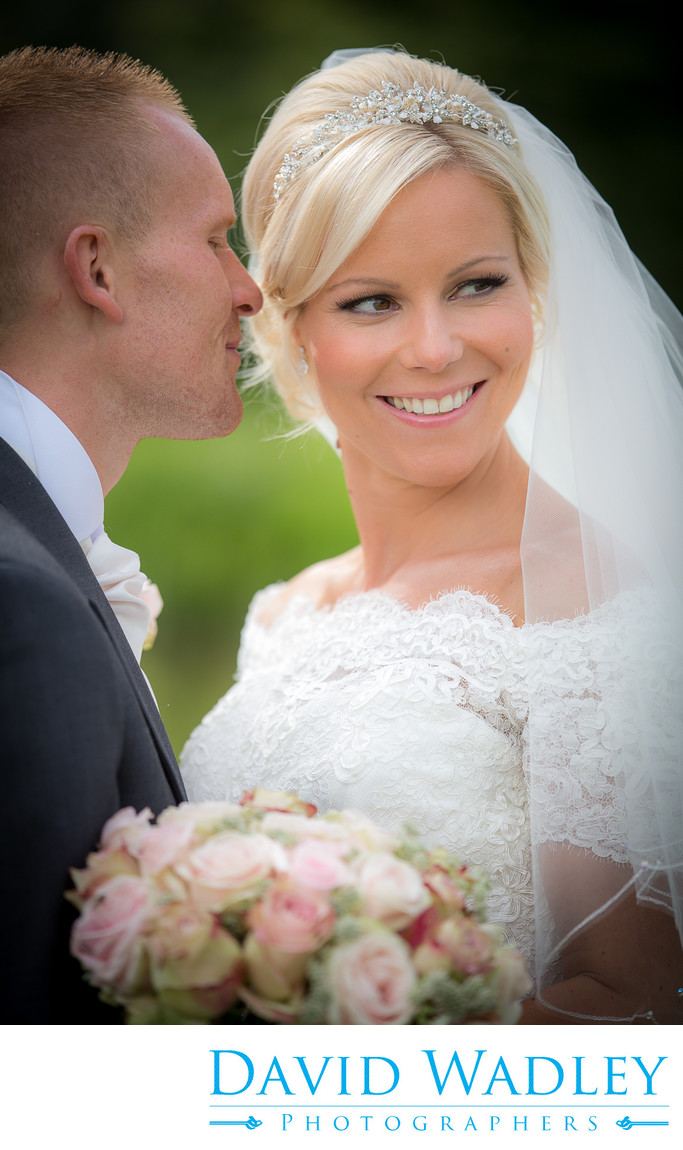 Groom whispering to his bride at Nailcote hall.