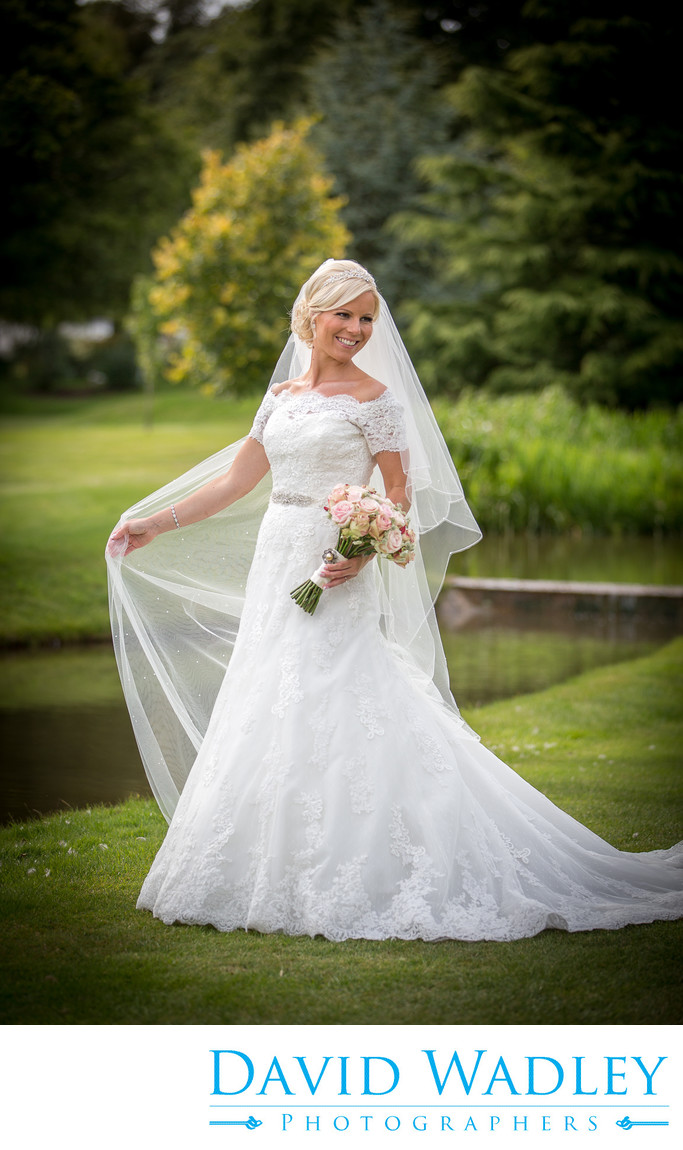 Bride in the  beautiful gardens at Nailcote Hall.