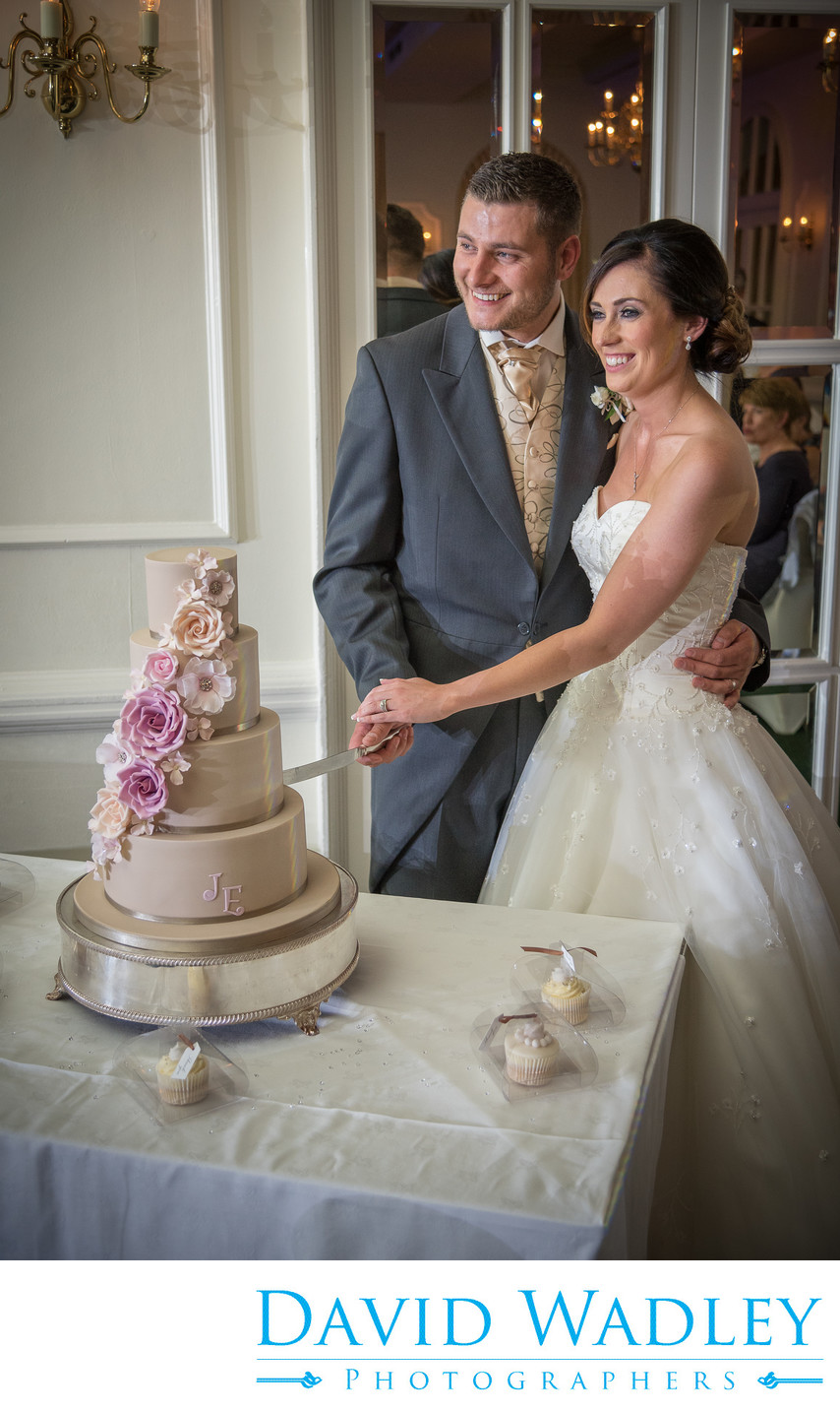 Cutting the Wedding cake at Moor Hall Hotel.