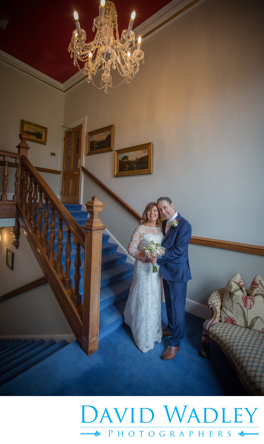 Bride & Groom on their wedding day on stairs at Grafton Manor.