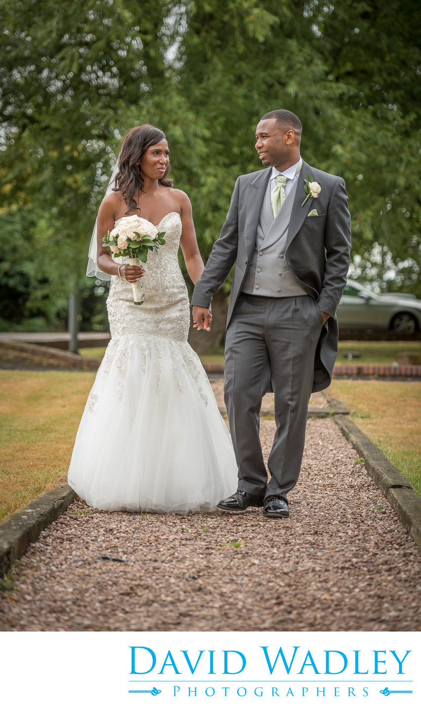 Brook Marston Farm Hotel Bride i& Groom Walking
