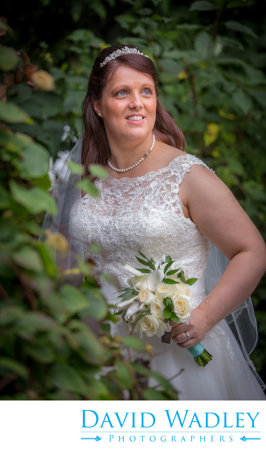 Bride in garden at Nailcote Hall