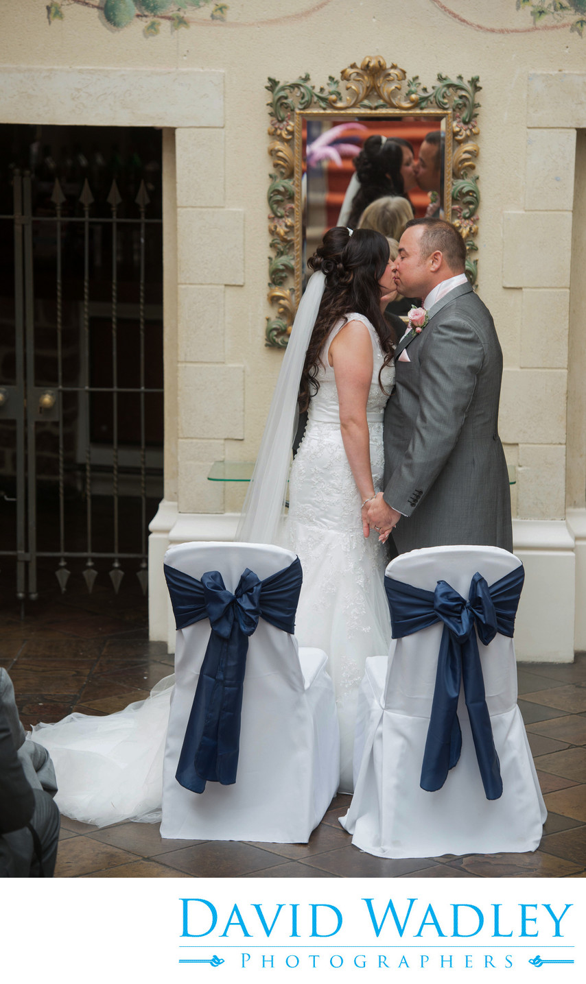 A kiss seals their wedding at Nailcote Hall.