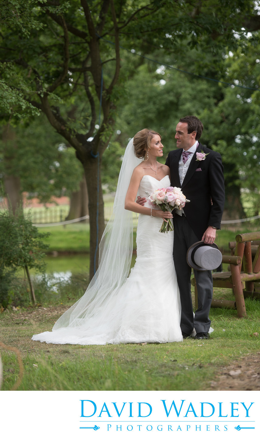 Bride & Groom next to lake at Nailcote Hall.