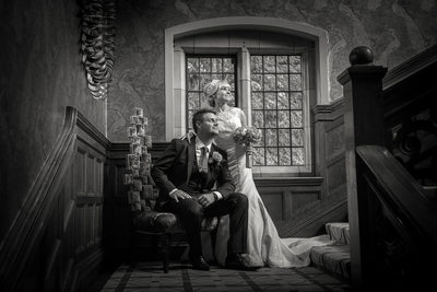 Bride & Groom on staircase during their Wedding at Moxhull Hall.