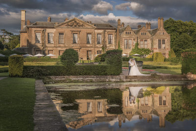 Coombe Abbey West Terrace with Bride and Groom after their Wedding.