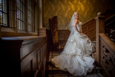 Bride photographed on the stunning staircase at Moxhull Hall Hotel on her wedding day.