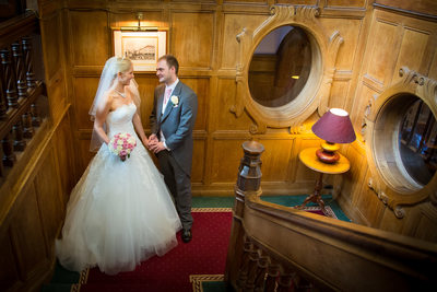 Bride & Groom photographed together on staircase at Moor Hall Hotel.