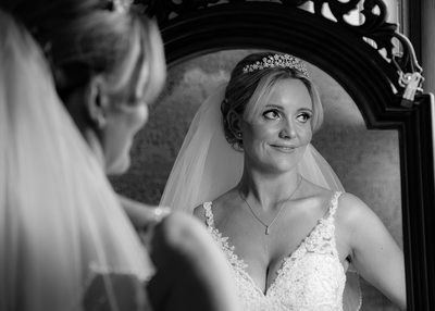 Bride with mirror at Grafton Manor.
