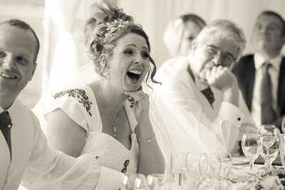 Bride enjoying speeches at Grafton Manor.
