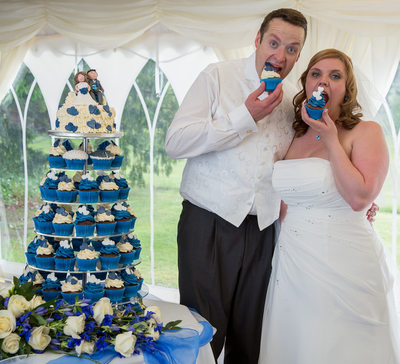 Eating cupcakes  at Grafton Manor on their wedding day.