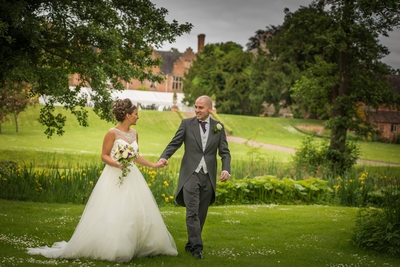 Wedding day walk for the couple at gorgeous Grafton Manor in Bromsgrove