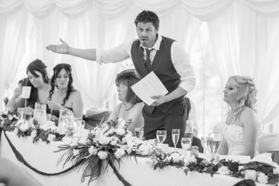 Groom making wedding speech during wedding breakfast at Grafton Manor.