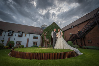 Bride & Groom in Forest of Arden courtyard.