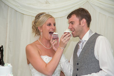 Brook Marston Farm Hotel Bride & Groom Eating Cupcakes