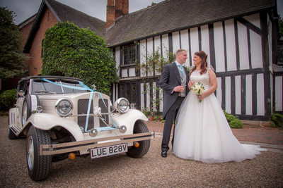 Wedding car with bride & Groom outside Nailcote Hall