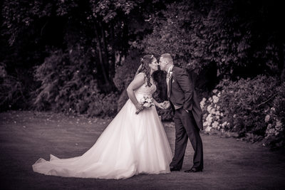 Bride & Groom holding hands at Nailcote Hall.
