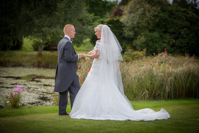 Bride & Groom talking in the grounds of Nailcote Hall.