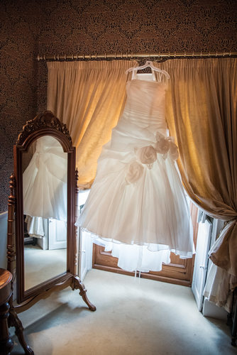 Wedding dress at Grafton Manor reflected in mirror.