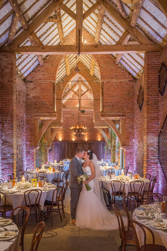 Shustoke Barn Bride & Groom kissing between wedding Breakfast.