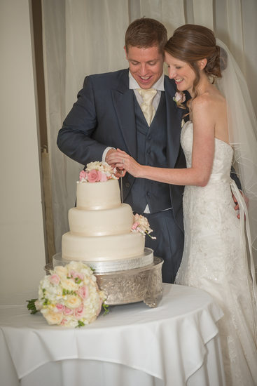 Cutting the wedding cake at Warwick House.