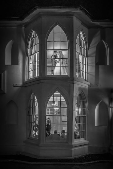 Bride & Groom together in the window at Warwick House