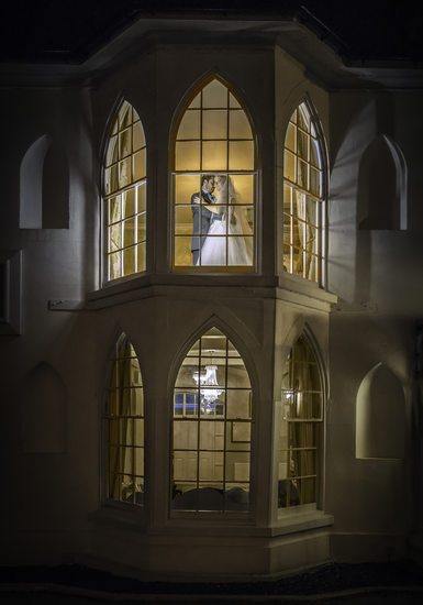 Bride & Groom in Windows at Warwick House
