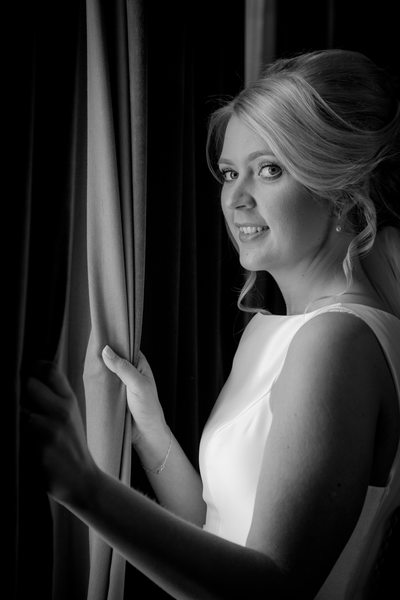Bride looking out on her wedding day at Grafton Manor Hotel Bromsgrove.