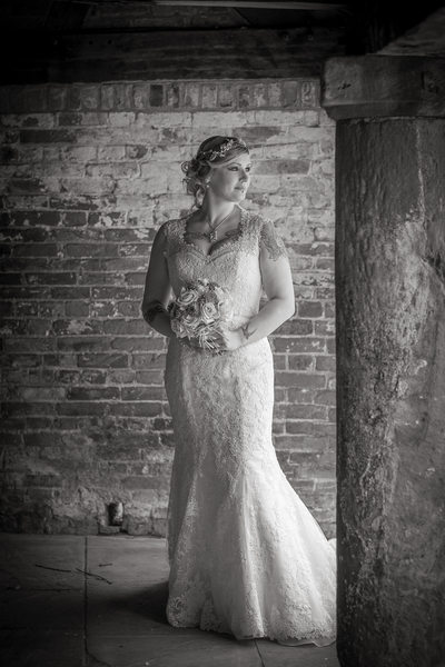 Bride in the courtyard of Shustoke Barn.