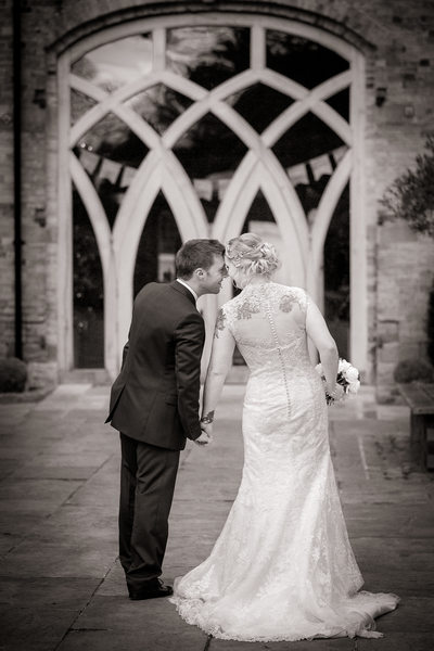 Bride & Groom in the courtyard of Shustoke Barns.