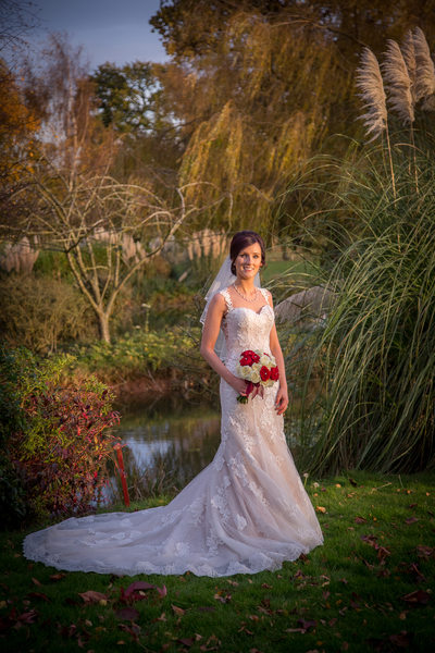 Bride next to lake at Nailcote Hall Hotel