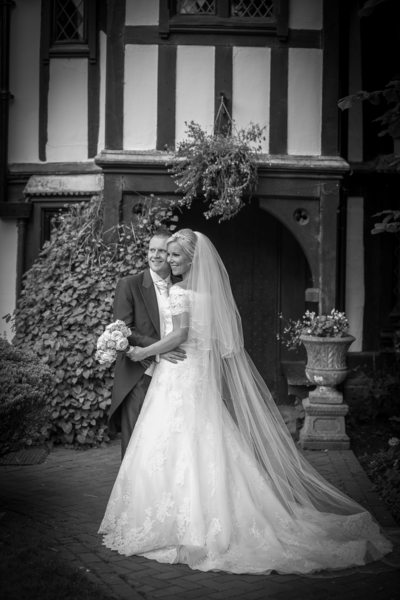 Nailcote Hall doorway framed the Bride & Groom.