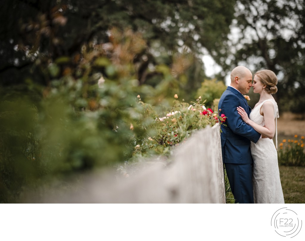 Couple on Fence Best Wedding Photographers Sacramento