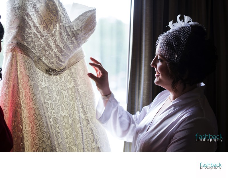 Mother Admiring Daughters Wedding Dress
