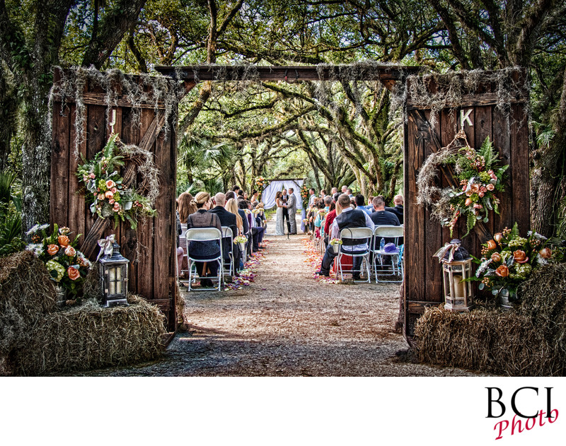 An outdoor wedding in Florida thru custom wood doors.