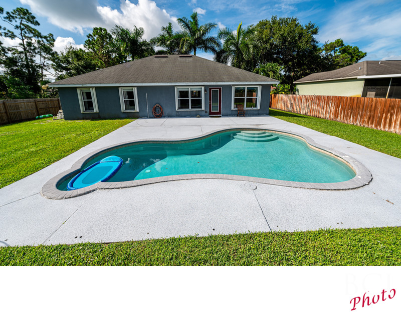 Outdoor real estate photo showing pool home in Florida