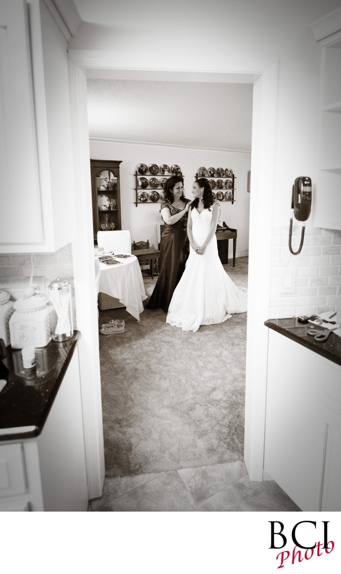 Bride and mom enjoy a tender moment before the wedding