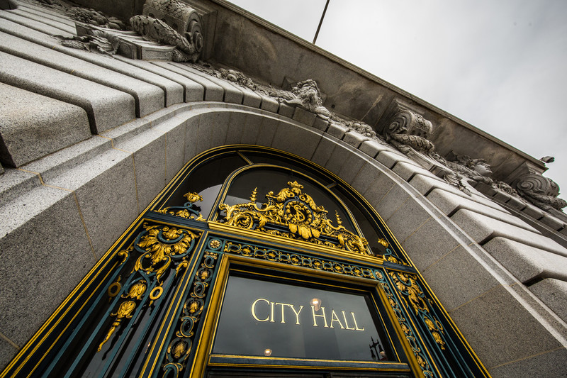 Wide angle view of City Hall doors sign