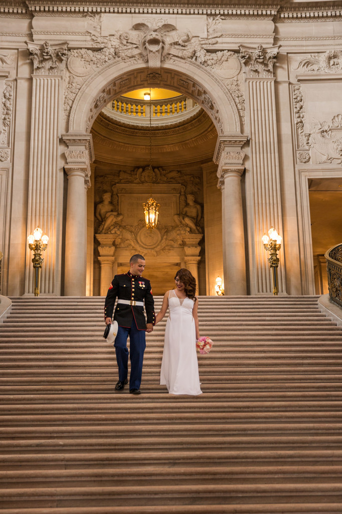 Bride and groom descend grand staircase at City Hall