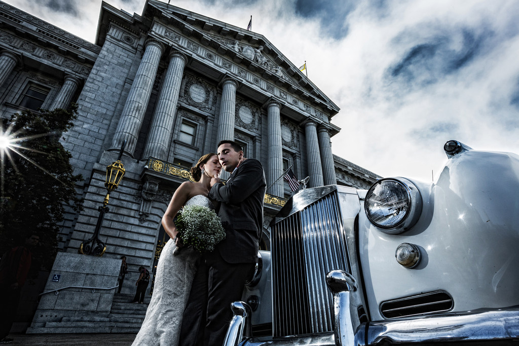 Bride, groom Rolls Royce in front of SF City Hall