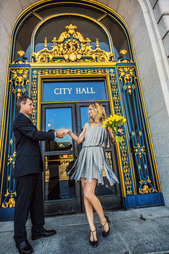 Bride in silver dress by City Hall doors
