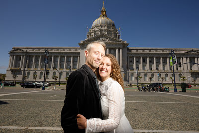 wedding couple in front of sf city hall